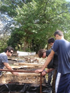 Zach and Matthew making raised plant beds with 2 students from the Green Valley School.